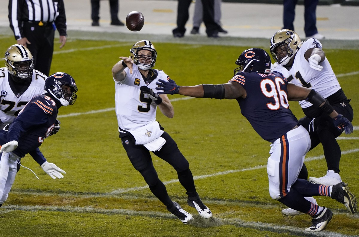 Nov 1, 2020; Chicago, Illinois, USA; Chicago Bears defensive end Akiem Hicks (96) puts pressure on New Orleans Saints quarterback Drew Brees (9) during the fourth quarter at Soldier Field. Mandatory Credit: Mike Dinovo-USA TODAY