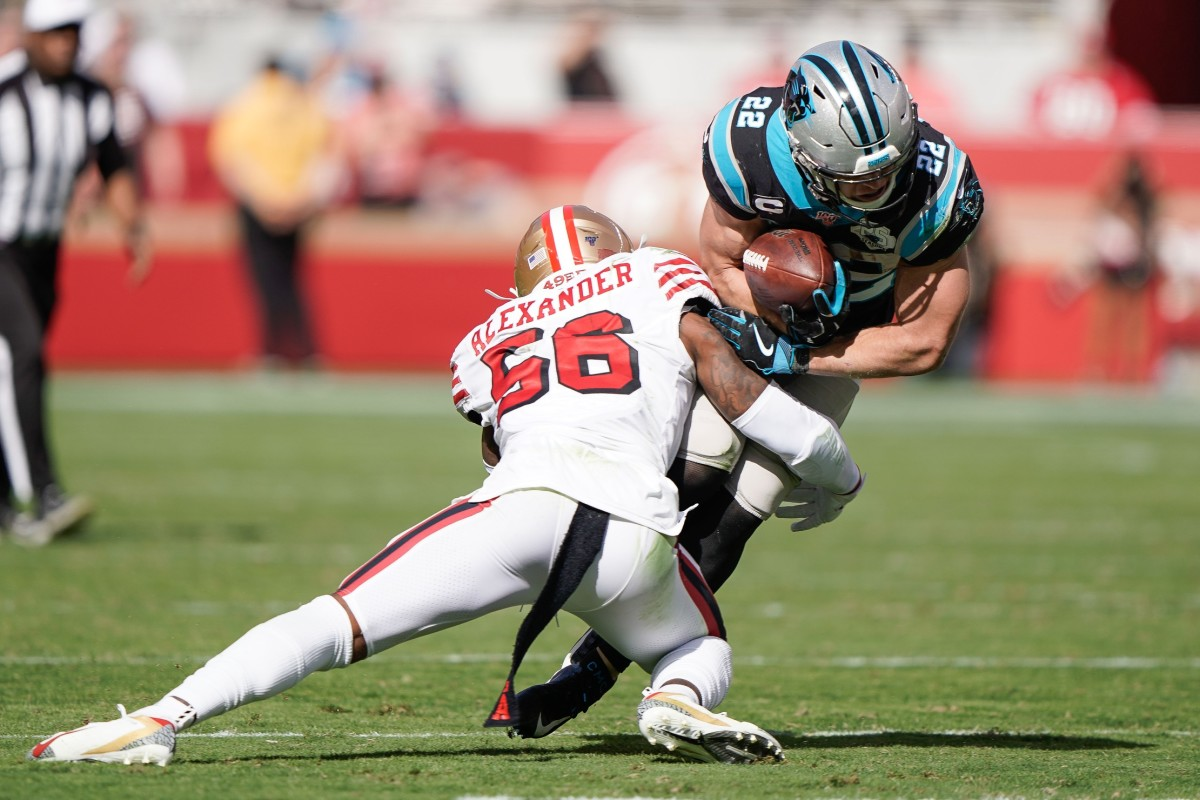 Oct 27, 2019; Santa Clara, CA, USA; San Francisco 49ers middle linebacker Kwon Alexander (56) tackles Carolina Panthers running back Christian McCaffrey (22) during the second quarter at Levi's Stadium. Mandatory Credit: Stan Szeto-USA TODAY