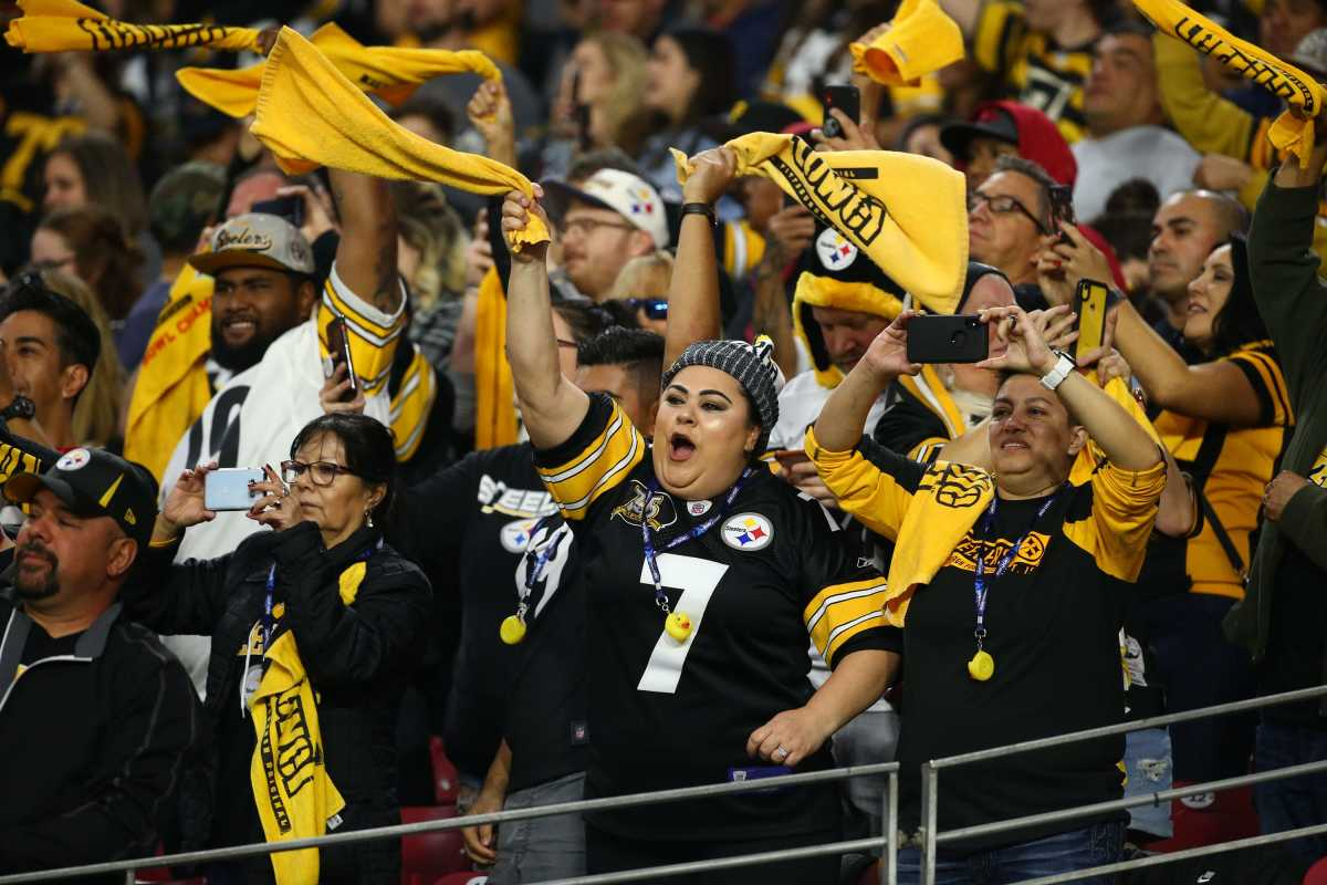 Steelers fans wave their Terrible Towels in the first half of a 2019 game against the Cardinals.