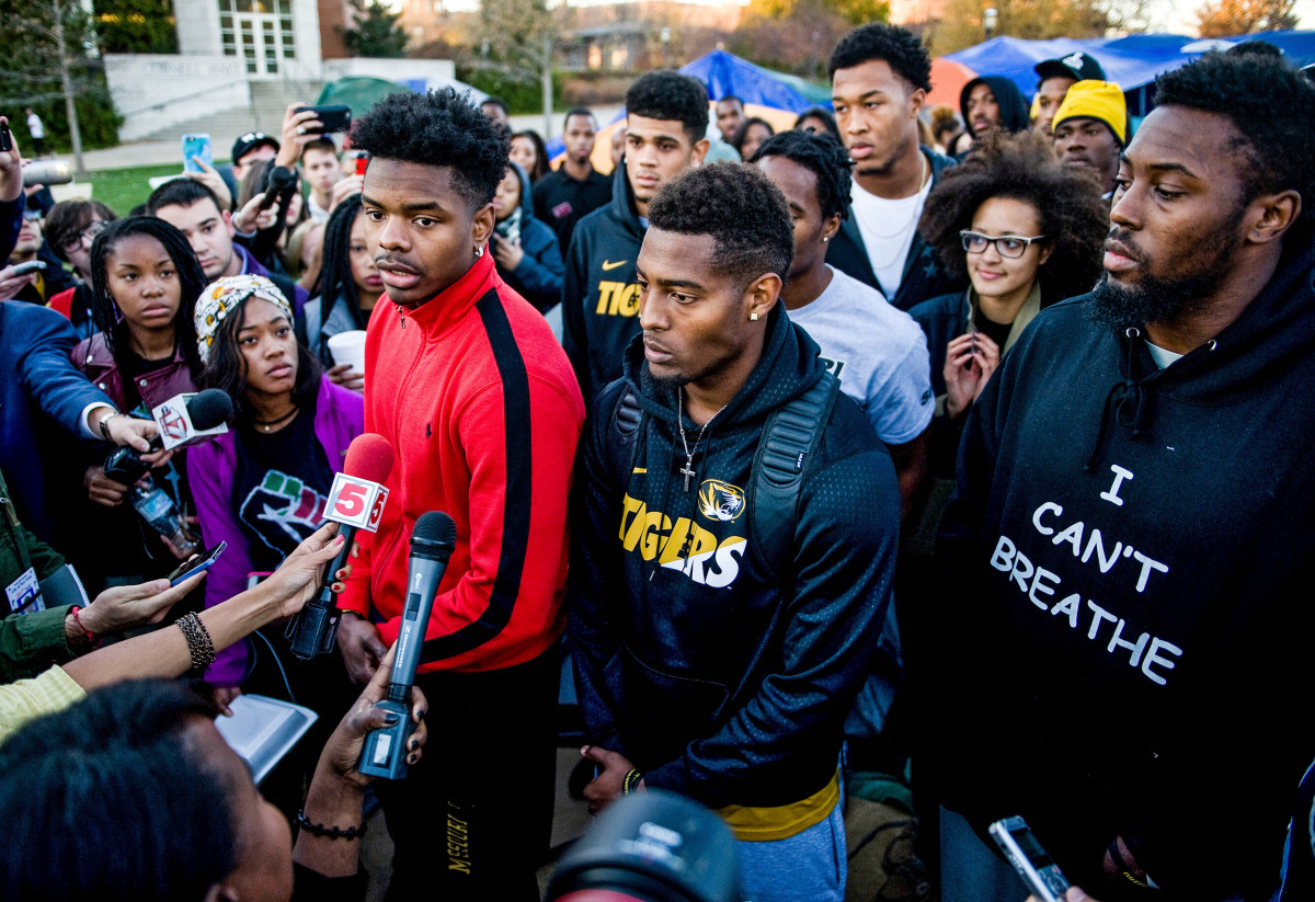 Moore (left), Simon (middle), Harris (right) and Ervin (behind, in glasses) were all key to the team's protest.