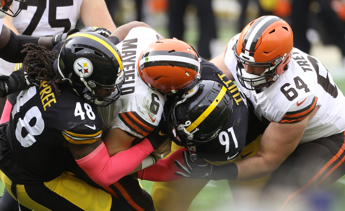 Steelers outside linebacker Bud Dupree (48) and defensive end Stephon Tuitt (91) combine to sack Browns quarterback Baker Mayfield (6) during the first quarter at Heinz Field in Pittsburgh, Oct. 18, 2020.