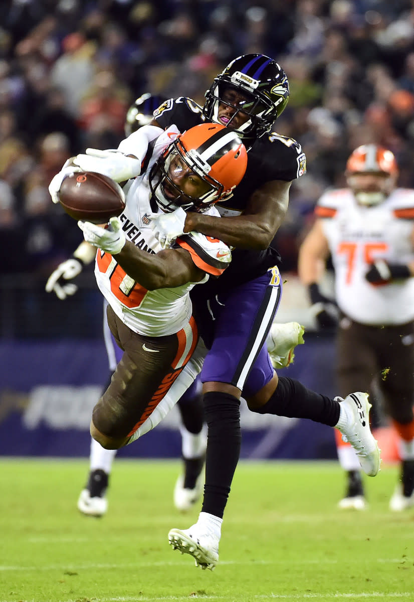 Browns wide receiver Jarvis Landry (80) cannot catch a pass while being defended by Ravens cornerback Tavon Young (25) at M&T Bank Stadium in Baltimore, Dec. 30, 2018.