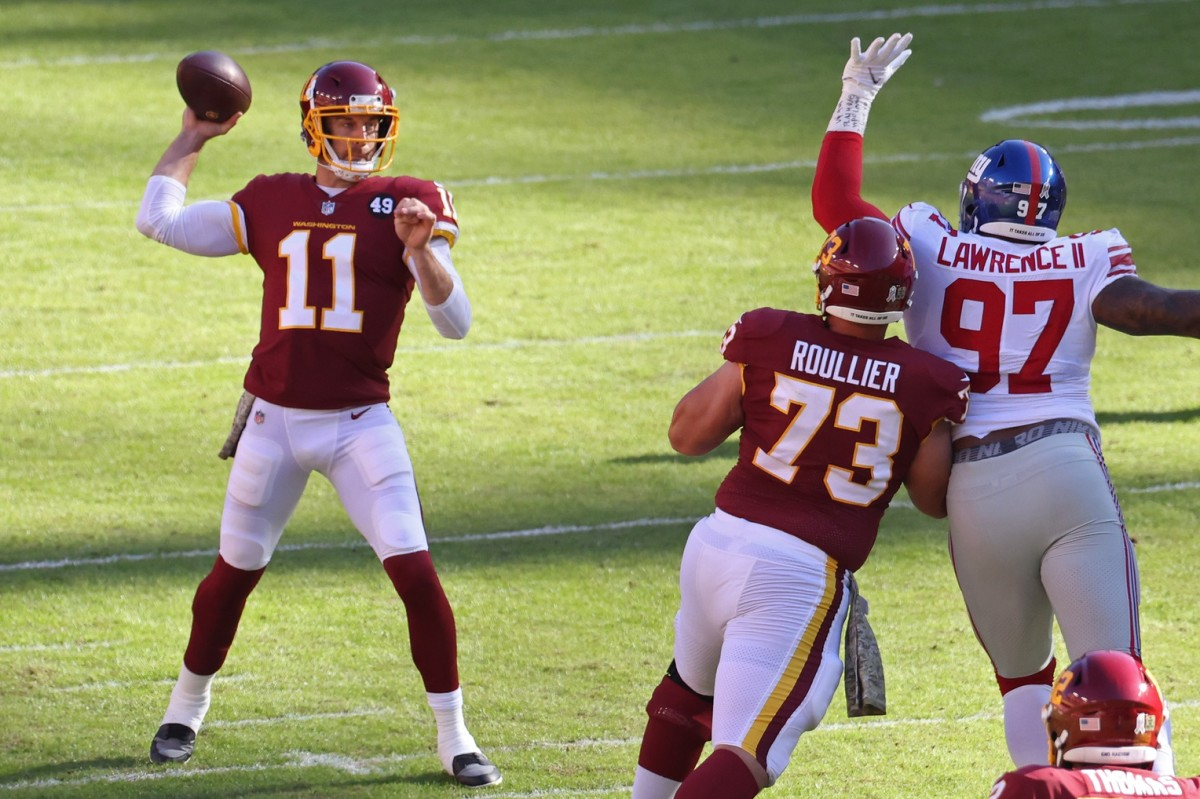 Nov 8, 2020; Landover, Maryland, USA; Washington Football Team quarterback Alex Smith (11) passes the ball as New York Giants defensive end Dexter Lawrence (97) defends in the first quarter at FedExField.