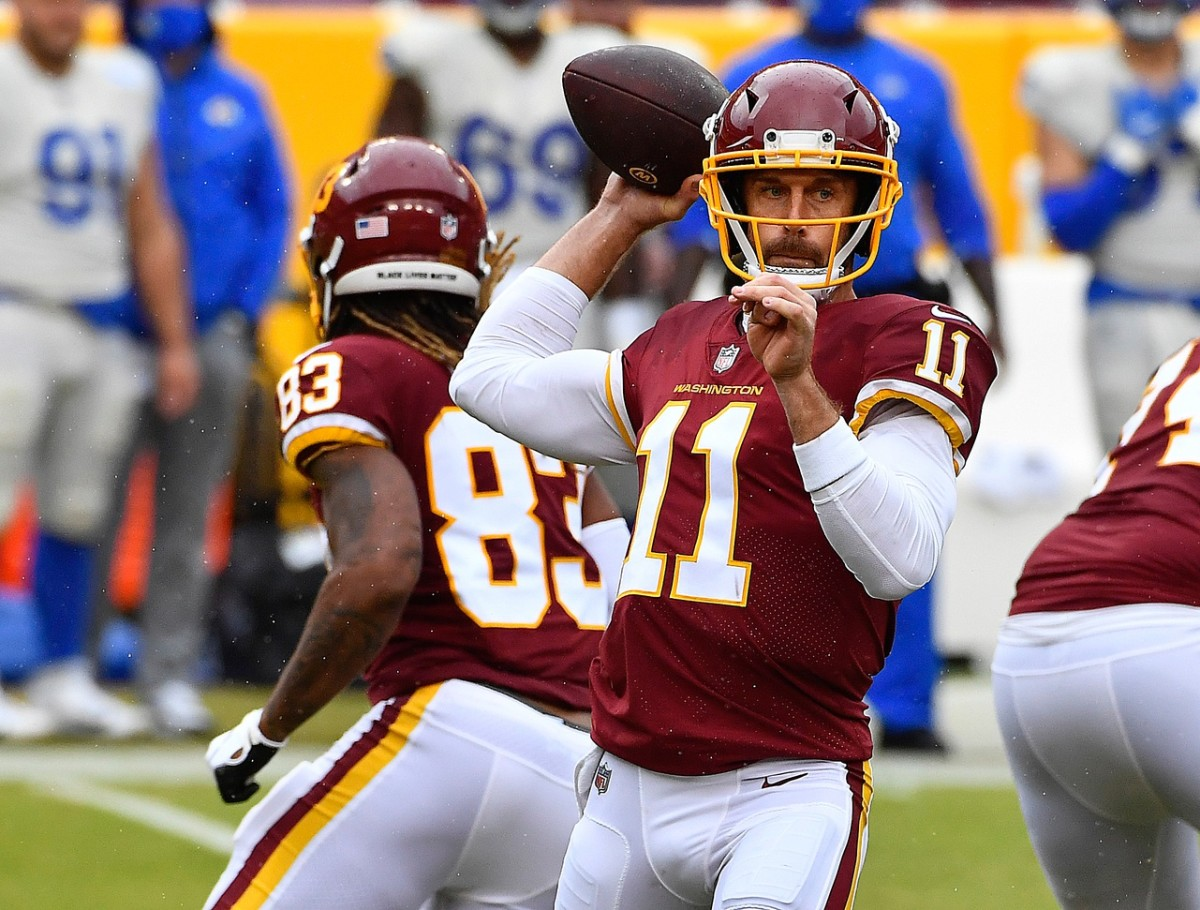 Oct 11, 2020; Landover, Maryland, USA; Washington Football Team quarterback Alex Smith (11) attempts a pass against the Los Angeles Rams during the second quarter at FedExField.