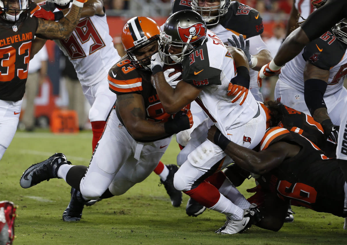 Former Cleveland defensive end Chris Hughes (93) makes a tackle against the Tampa Bay in the 2016 preseason. Hughes was one of few bright spots the Browns had among the players they selected in the 2012 NFL Draft.