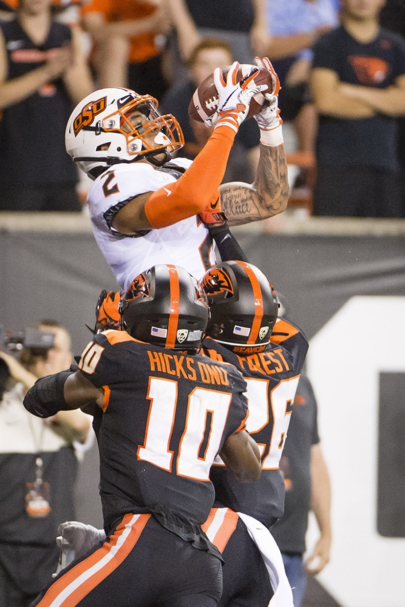 Aug 30, 2019; Corvallis, OR, USA; Oklahoma State Cowboys wide receiver Tylan Wallace (2) catches a touchdown pass against Oregon State Beavers defensive back Jojo Forest (26) during the first half at Reser Stadium. Mandatory Credit: Troy Wayrynen-USA TODAY Sports
