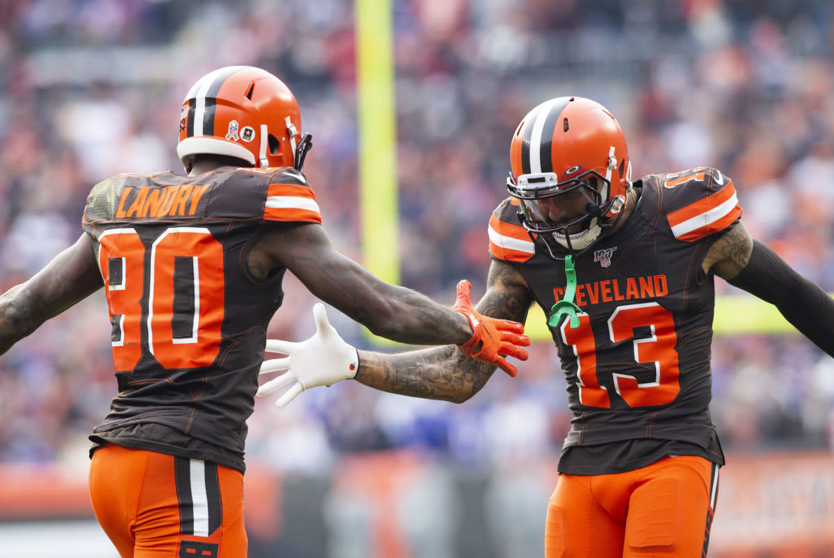Browns wide receiver Jarvis Landry (80) celebrates with wide receiver Odell Beckham (13) after scoring a touchdown during a 2019 game against the Bills.