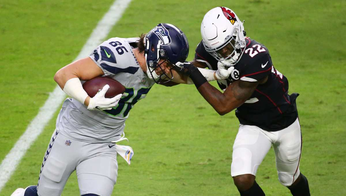 Seahawks tight end Jacob Hollister (86) drives forward with the ball against Cardinals safety Deionte Thompson (22). The Seahawks are the Cardinals' newest rival.