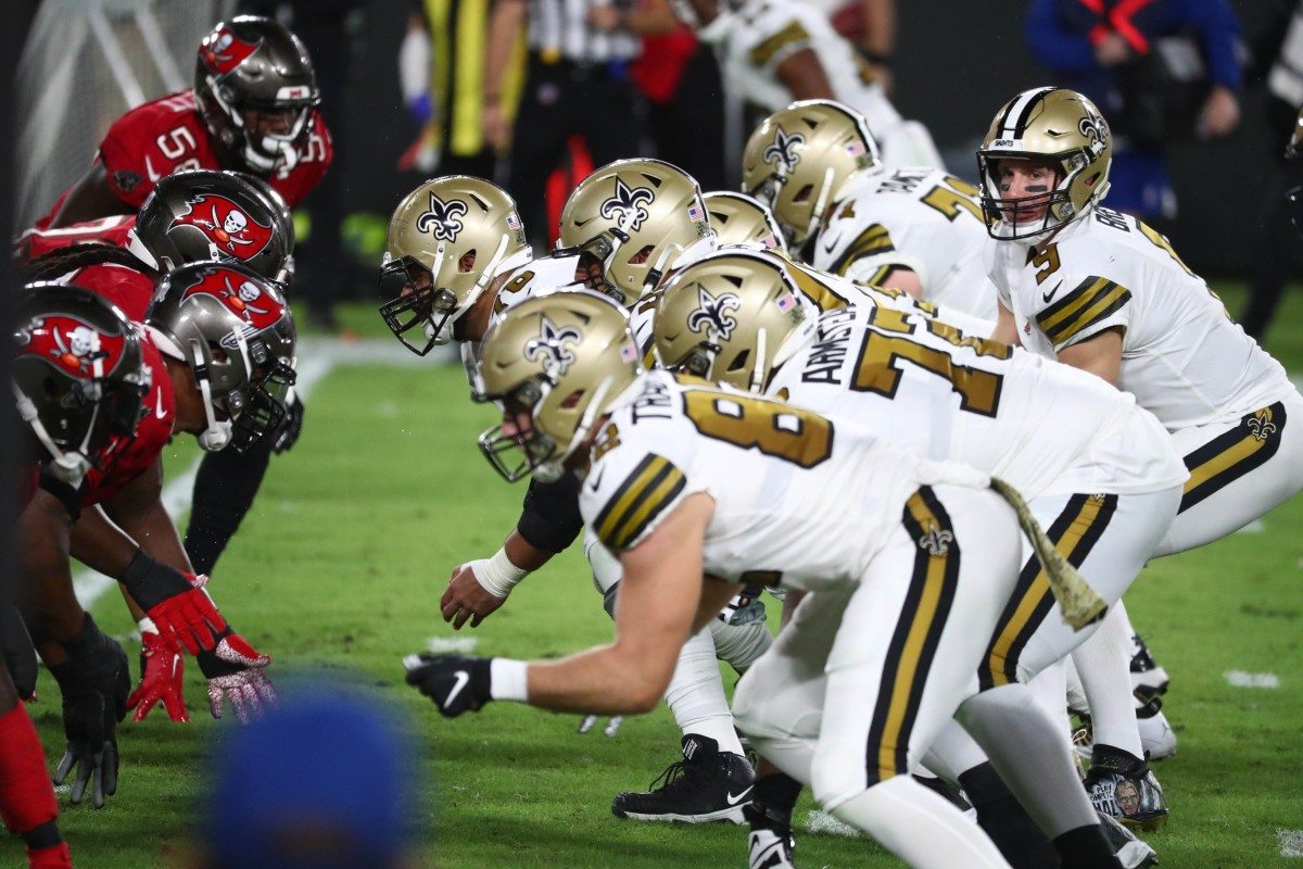 Nov 8, 2020; Tampa, Florida, USA; New Orleans Saints quarterback Drew Brees (9) under center against the Tampa Bay Buccaneers in the first quarter of a NFL game at Raymond James Stadium. Mandatory Credit: Kim Klement-USA TODAY