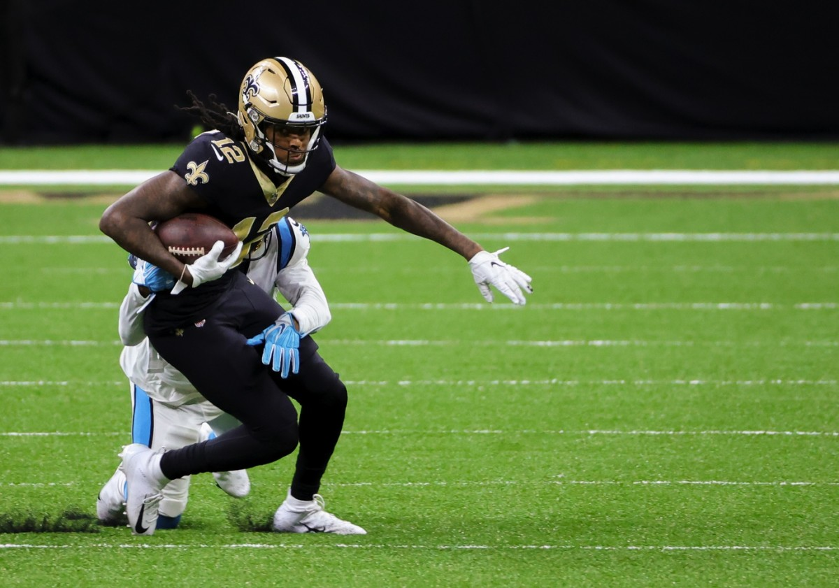 Oct 25, 2020; New Orleans, Louisiana, USA; New Orleans Saints wide receiver Marquez Callaway (12) is tackled by Carolina Panthers running back Jordan Scarlett (20) during the second half at the Mercedes-Benz Superdome. Mandatory Credit: Derick E. Hingle-USA TODAY