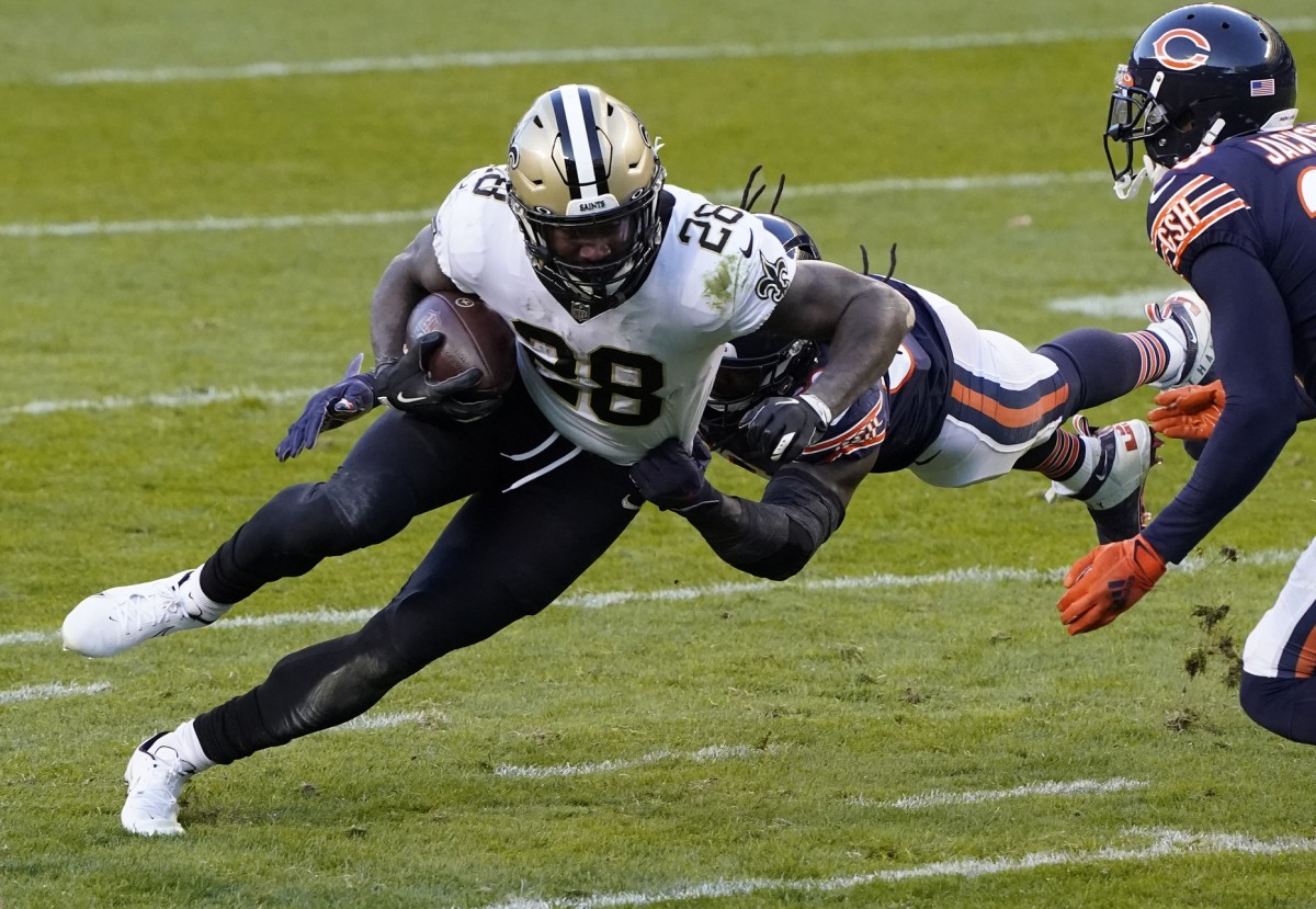 Nov 1, 2020; Chicago, Illinois, USA; New Orleans Saints running back Latavius Murray (28) rushes the ball against the Chicago Bears during the second quarter at Soldier Field. Mandatory Credit: Mike Dinovo-USA TODAY
