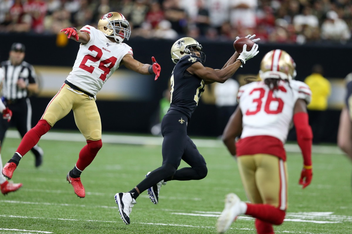 Dec 8, 2019; New Orleans, LA, USA; New Orleans Saints wide receiver Michael Thomas (13) makes a catch as San Francisco 49ers defensive back K'Waun Williams (24) defends in the second half at the Mercedes-Benz Superdome. Mandatory Credit: Chuck Cook-USA TODAY Sports