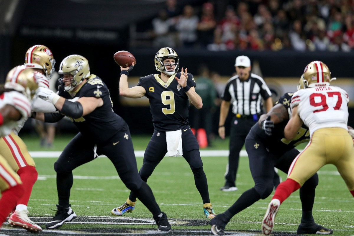 Dec 8, 2019; New Orleans, LA, USA; New Orleans Saints quarterback Drew Brees (9) throws while offensive guard Nick Easton (62) and offensive tackle Terron Armstead (72) block in the second half against the San Francisco 49ers at the Mercedes-Benz Superdome. The 49ers won, 48-46. Mandatory Credit: Chuck Cook-USA TODAY