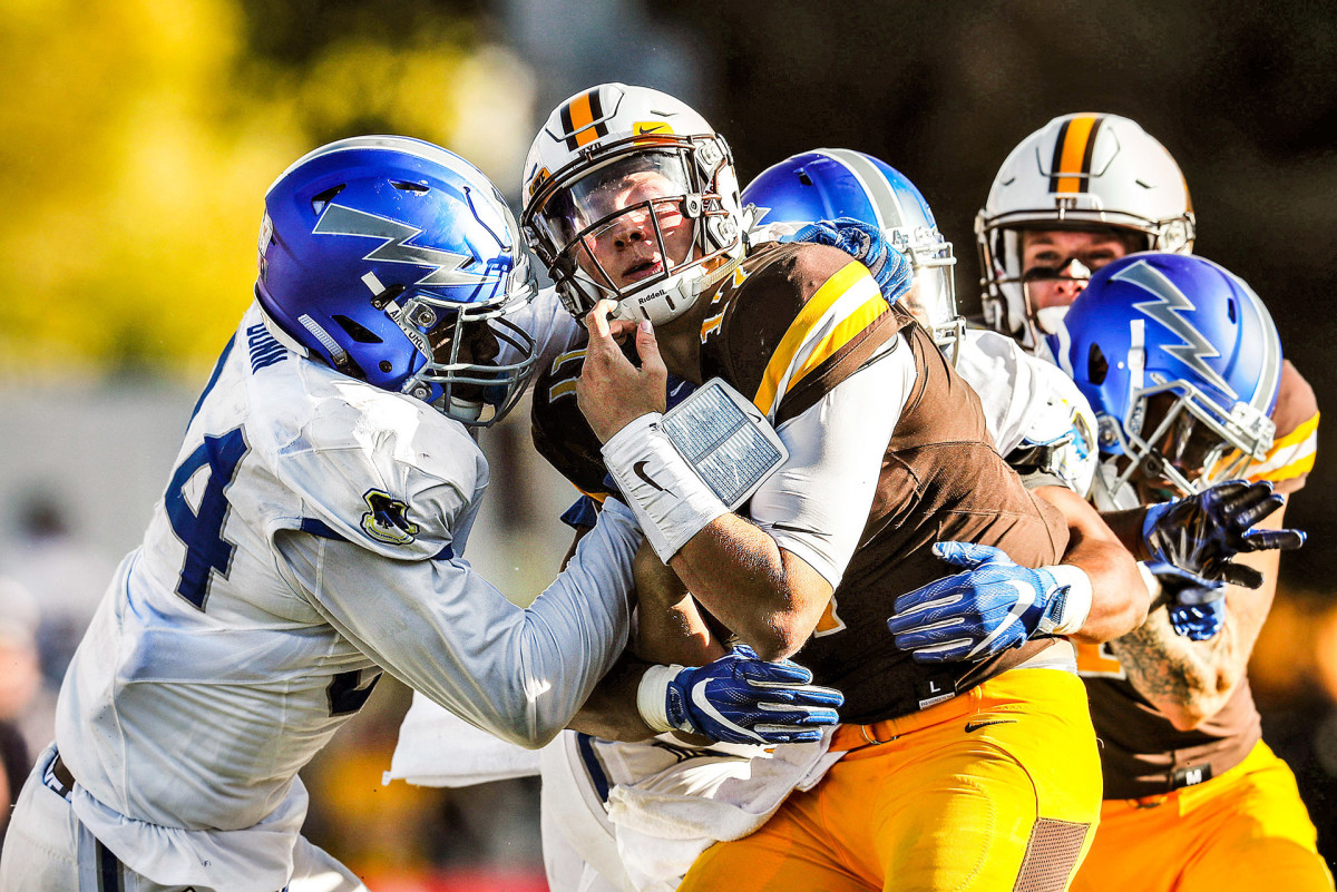 Josh Allen, playing at Wyoming, is sacked by Air Force defenders