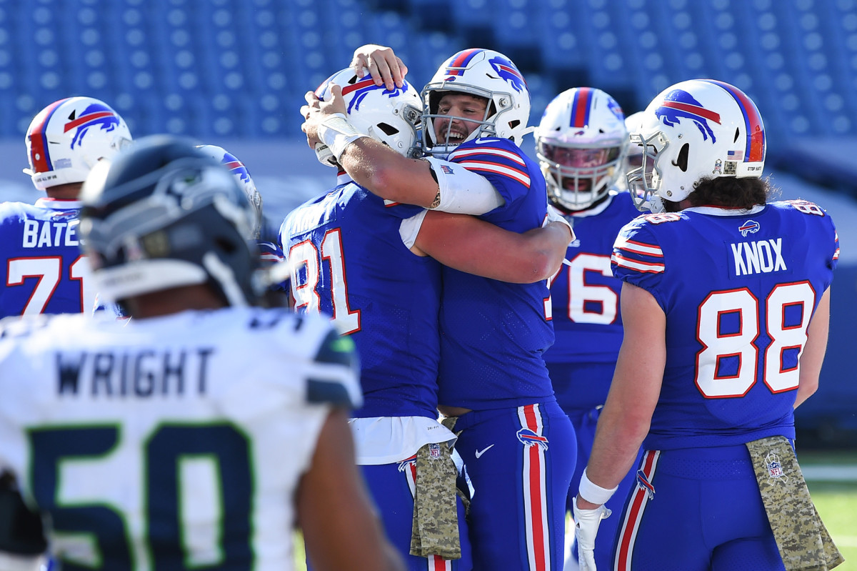 Josh Allen celebrates with teammates after throwing touchdown against Seahawks