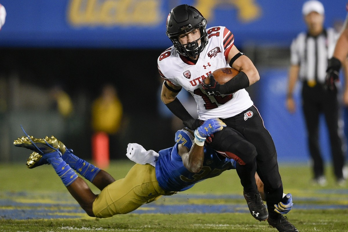 Oct 26, 2018; Pasadena, CA, USA; Utah Utes wide receiver Britain Covey (18) runs after the catch while defended by UCLA Bruins defensive back Quentin Lake (37) during the first half at Rose Bowl.