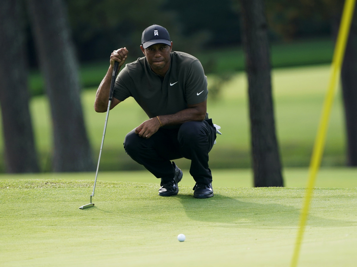 Nov 12, 2020; Augusta, Georgia, USA; Tiger Woods lines up his putt on the 7th green during the first round of The Masters golf tournament at Augusta National GC.