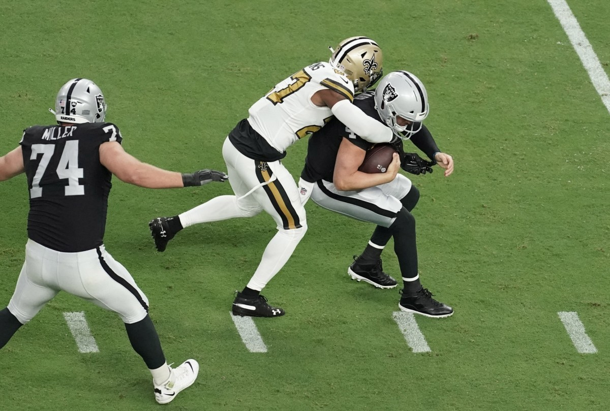 Sep 21, 2020; Paradise, Nevada, USA; Las Vegas Raiders quarterback Derek Carr (4) is sacked by New Orleans Saints strong safety Malcolm Jenkins (27) during the first quarter of a NFL game at Allegiant Stadium. Mandatory Credit: Kirby Lee-USA TODAY