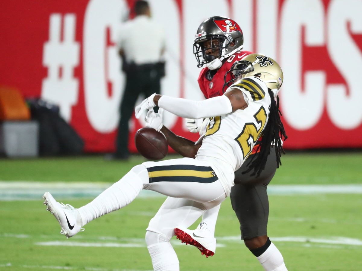 Nov 8, 2020; Tampa, Florida, USA; New Orleans Saints cornerback Janoris Jenkins (20) breaks up a pass intended for Tampa Bay Buccaneers receiver Antonio Brown (81) in the first quarter of a NFL game at Raymond James Stadium. Mandatory Credit: Kim Klement-USA TODAY Sports