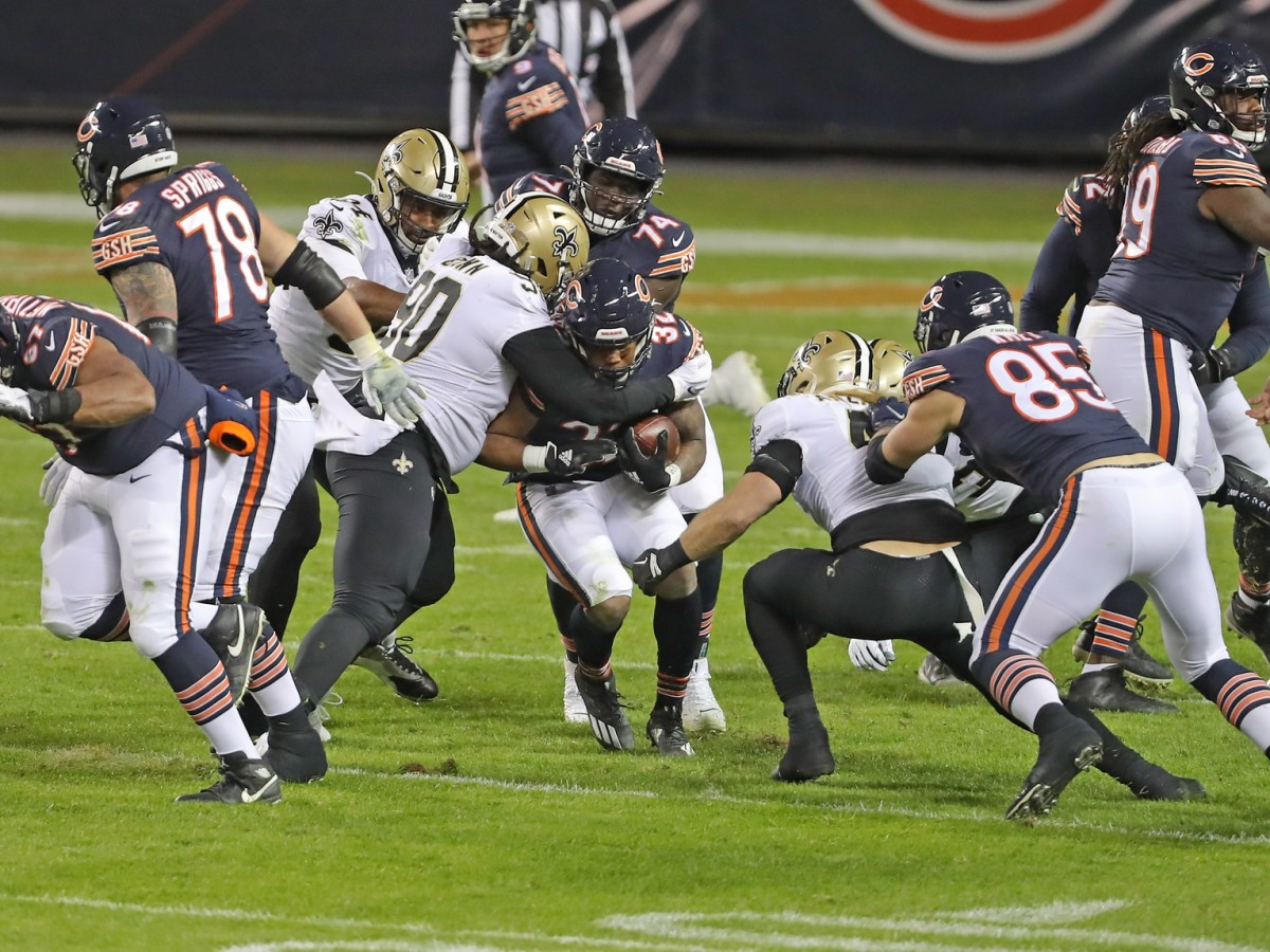 Nov 1, 2020; Chicago, Illinois, USA; Chicago Bears running back David Montgomery (32) runs with the ball with New Orleans Saints defensive tackle Malcom Brown (90) defending during the second half at Soldier Field. Mandatory Credit: Dennis Wierzbicki-USA TODAY