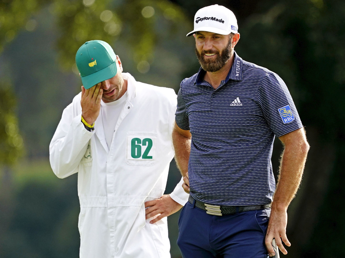 Dustin Johnson reacts with caddie and brother Austin Johnson after winning The Masters golf tournament