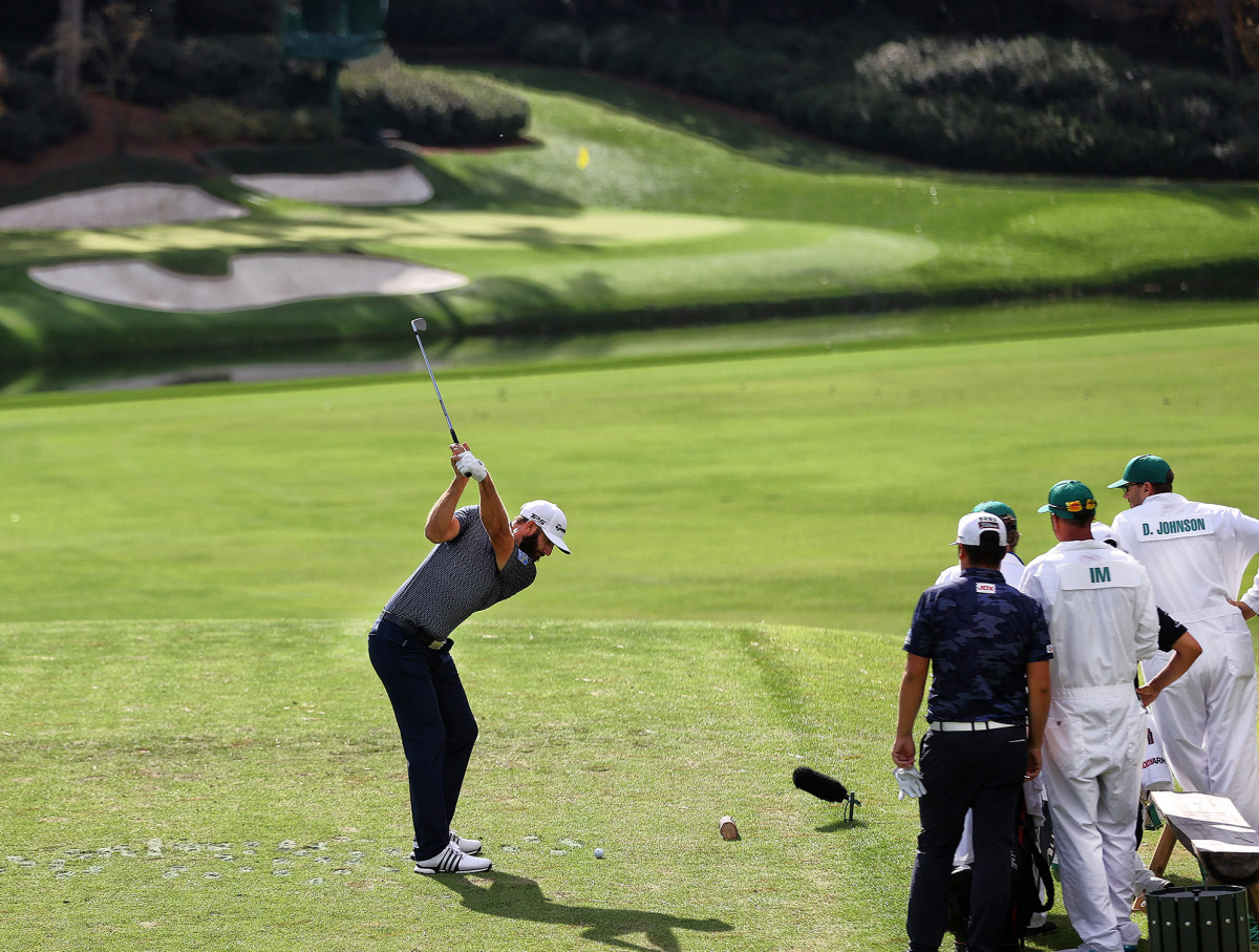 Dustin Johnson tees off at the Masters