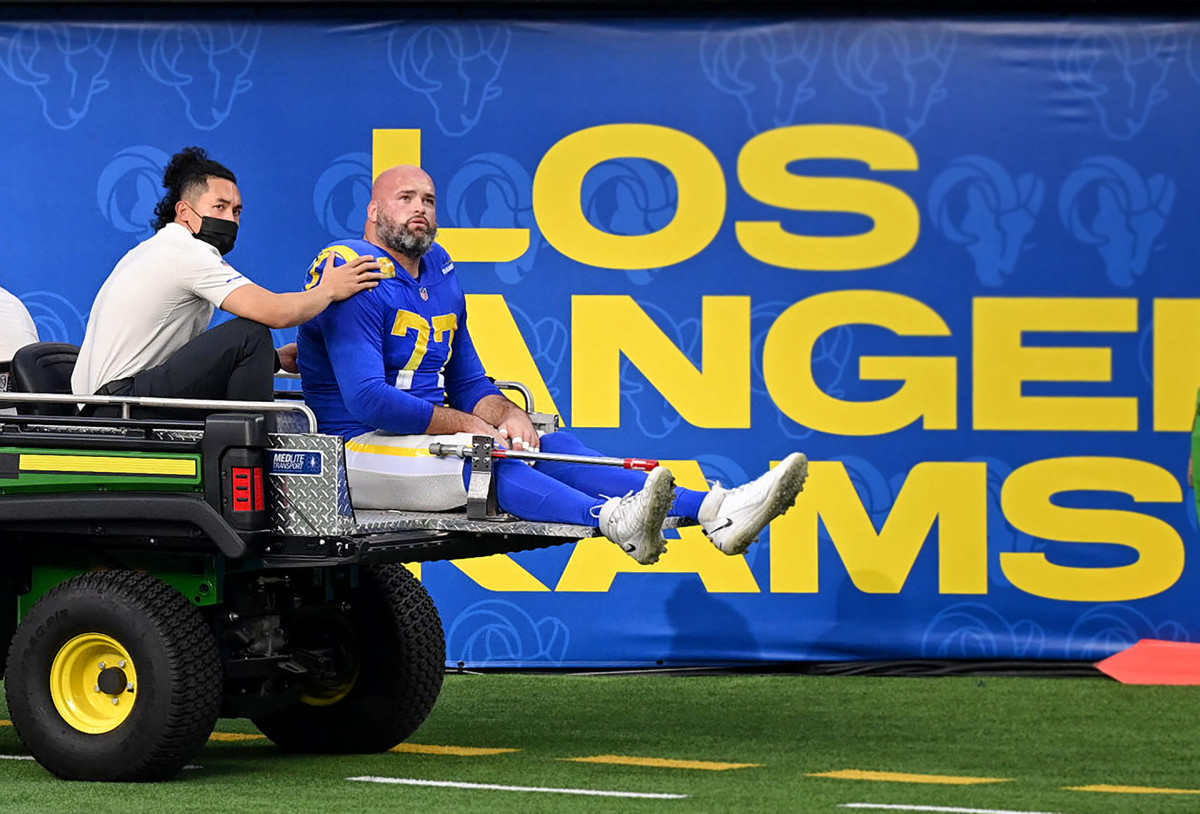 Andrew Whitworth looks up as he's carted off the field after suffering a knee injury against the Seahawks