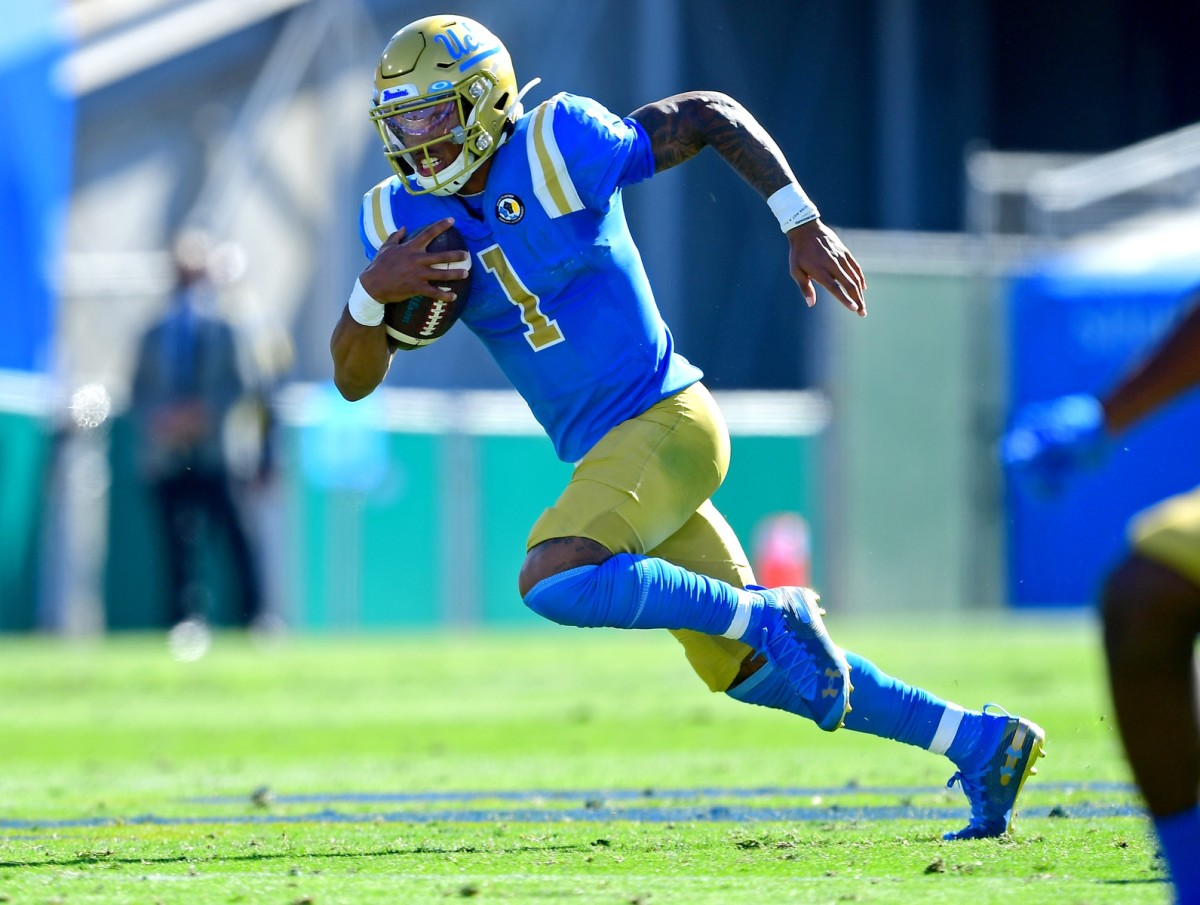 Nov 15, 2020; Pasadena, California, USA; UCLA Bruins quarterback Dorian Thompson-Robinson (1) runs in the second half against the California Golden Bears at the Rose Bowl.