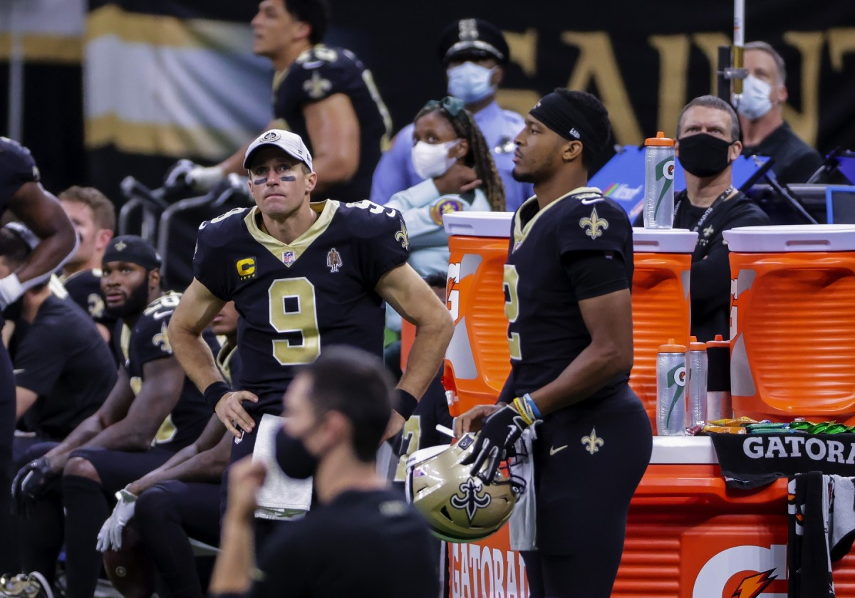 Nov 15, 2020; New Orleans, Louisiana, USA; New Orleans Saints quarterback Drew Brees (9) and quarterback Jameis Winston (2) on the sideline during the second half against the San Francisco 49ers at the Mercedes-Benz Superdome. Mandatory Credit: Derick E. Hingle-USA TODAY