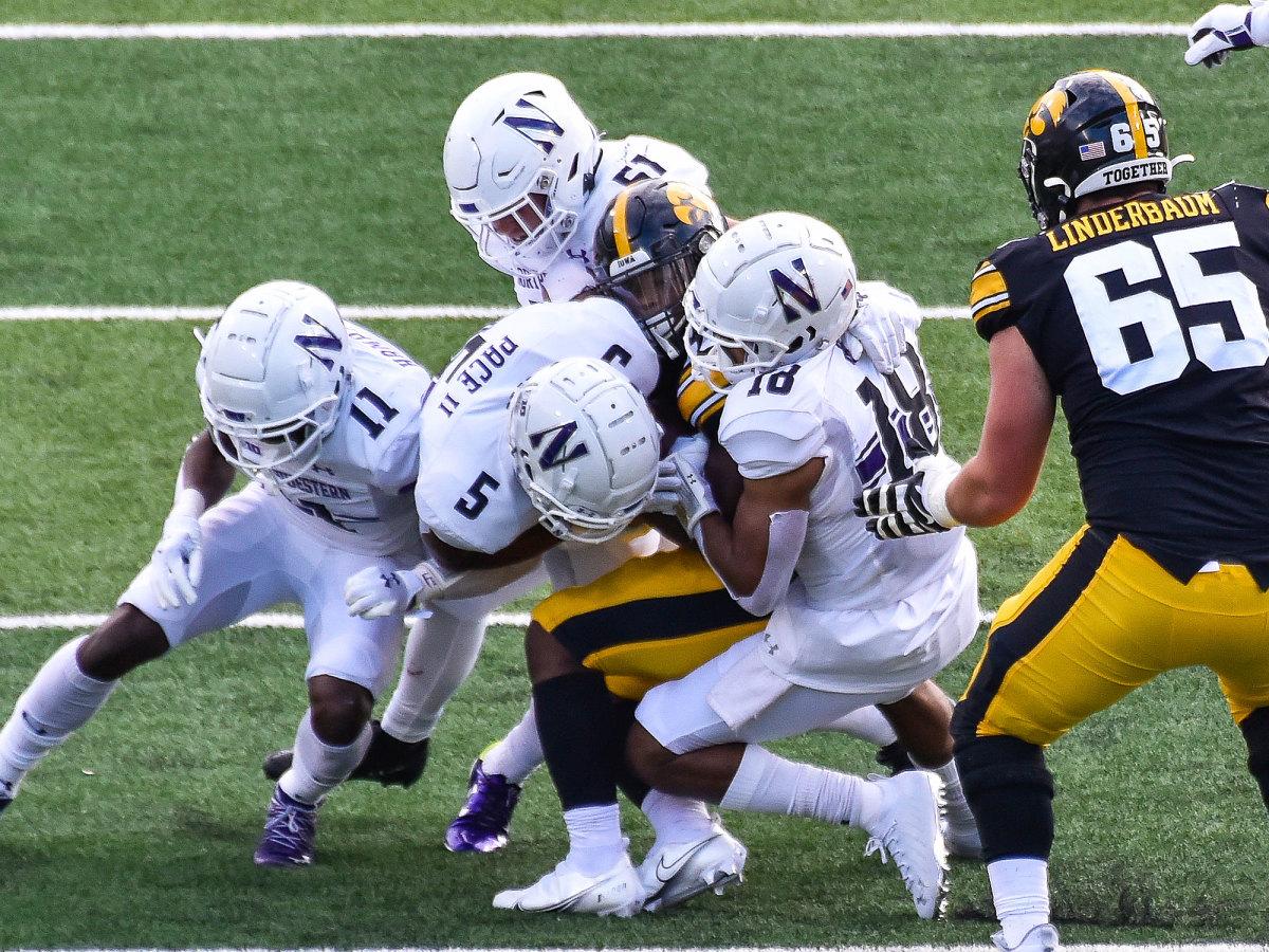 Northwestern's defense swarms an Iowa player