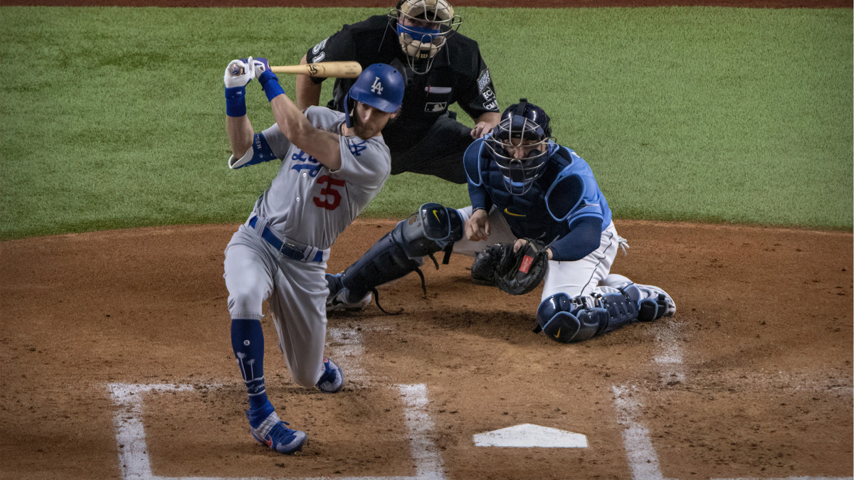Los Angeles Dodgers center fielder Cody Bellinger (35) hits a single and drives in a run against the Tampa Bay Rays during the first inning in game five of the 2020 World Series at Globe Life Field.