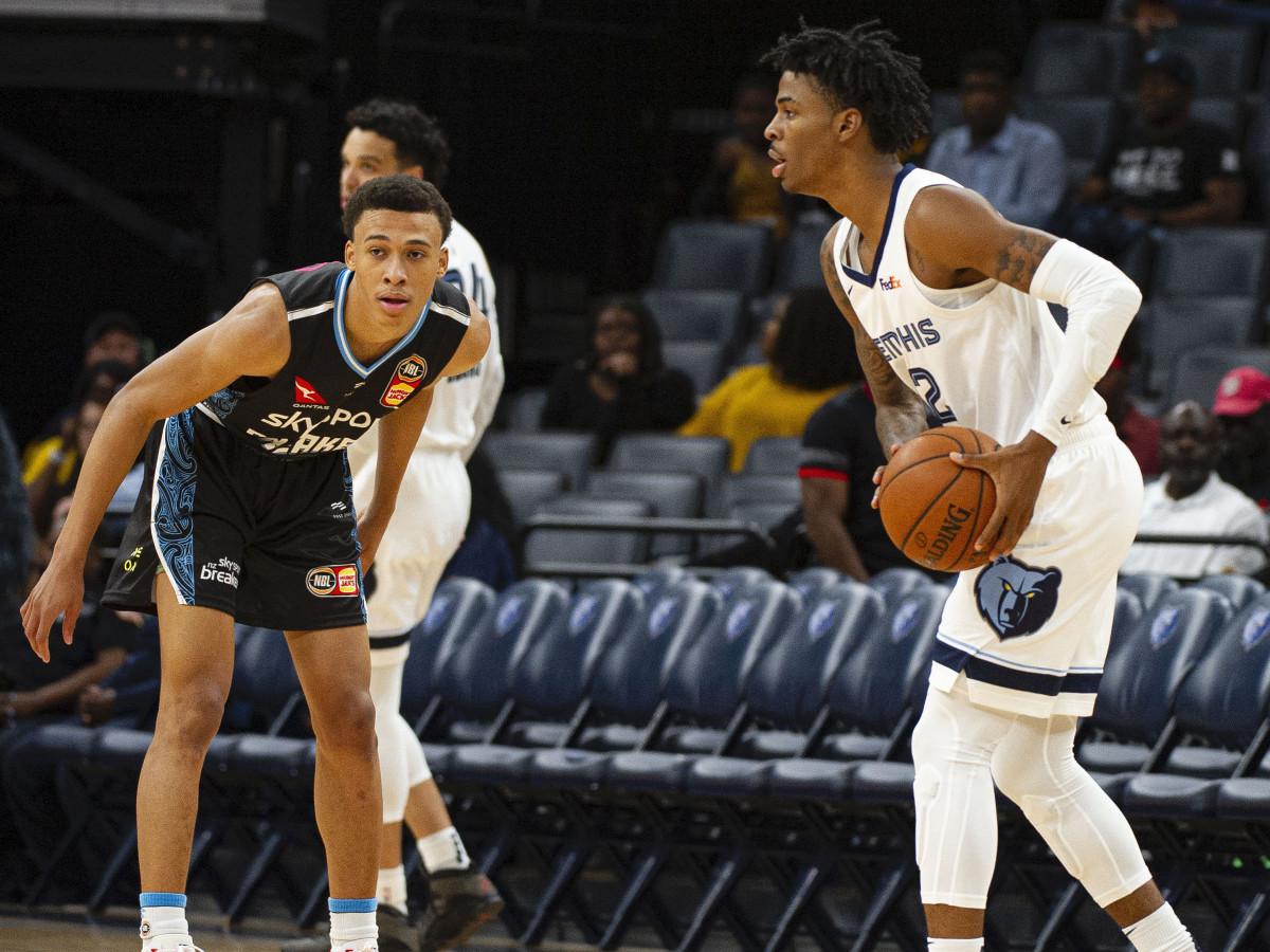 Memphis Grizzlies guard Ja Morant handles the ball against New Zealand Breakers guard R.J. Hampton during an October 2019 exhibition.