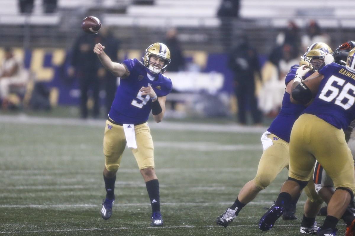 Nov 14, 2020; Seattle, Washington, USA; Washington Huskies quarterback Dylan Morris (9) passes against the Oregon State Beavers during the second quarter at Alaska Airlines Field at Husky Stadium.