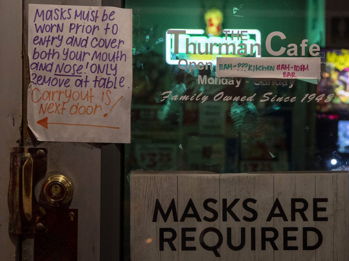A sign at Thurman's Cafe in Columbus tells patrons masks are required