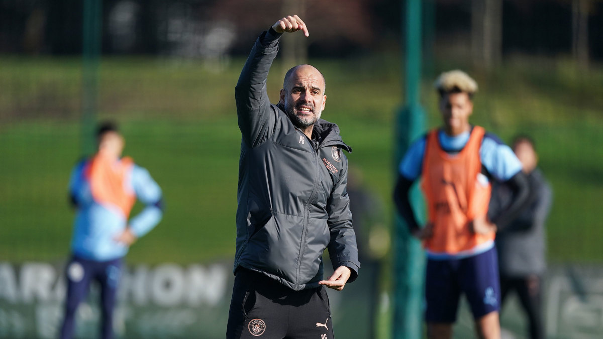 Pep Guardiola signs to coach Man City through 2023