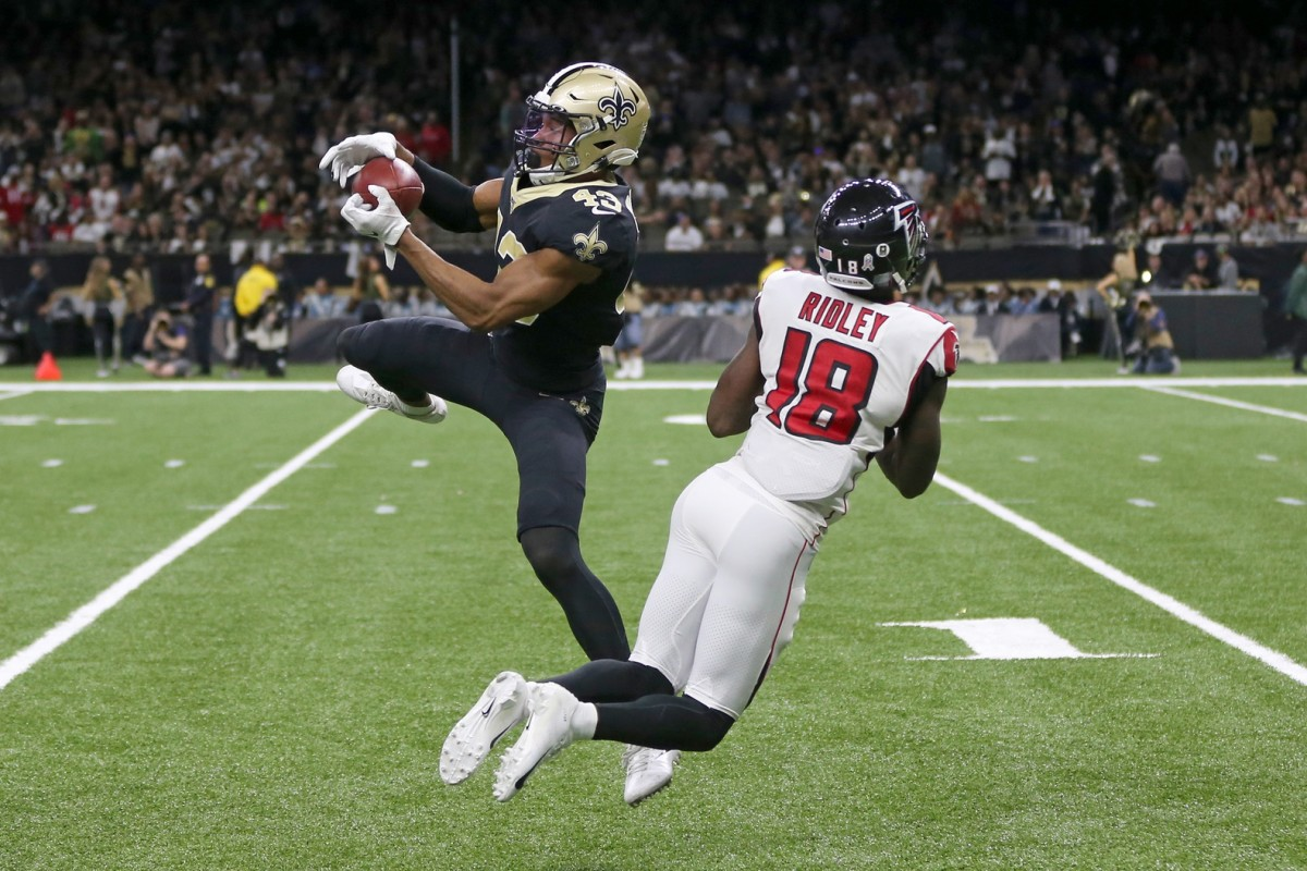 Nov 10, 2019; New Orleans, LA, USA; New Orleans Saints free safety Marcus Williams (43) intercepts a pass intended for Atlanta Falcons wide receiver Calvin Ridley (18) in the second half at the Mercedes-Benz Superdome. Mandatory Credit: Chuck Cook-USA TODAY