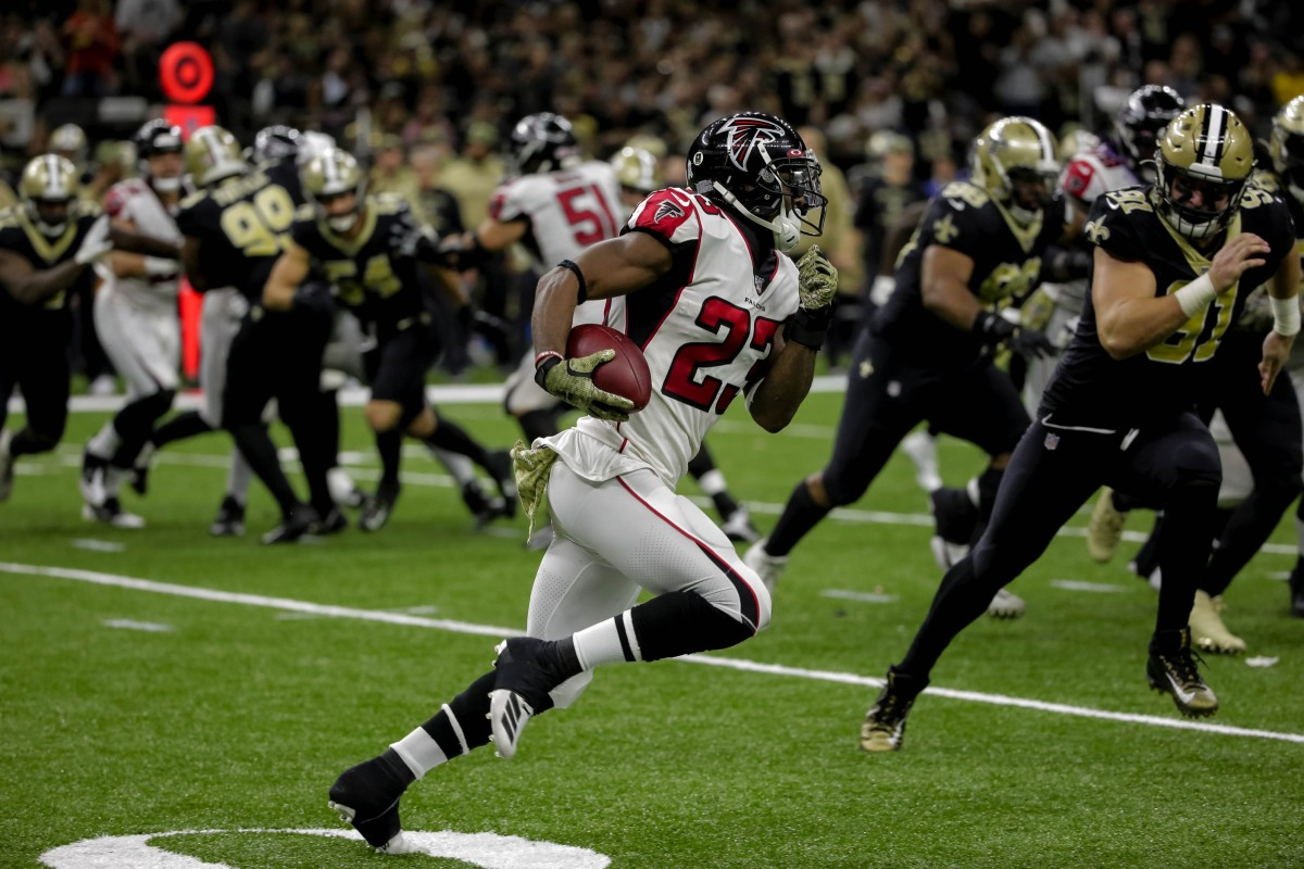 Nov 10, 2019; New Orleans, LA, USA; Atlanta Falcons running back Brian Hill (23) runs against the New Orleans Saints during the third quarter at the Mercedes-Benz Superdome. Mandatory Credit: Derick E. Hingle-USA TODAY