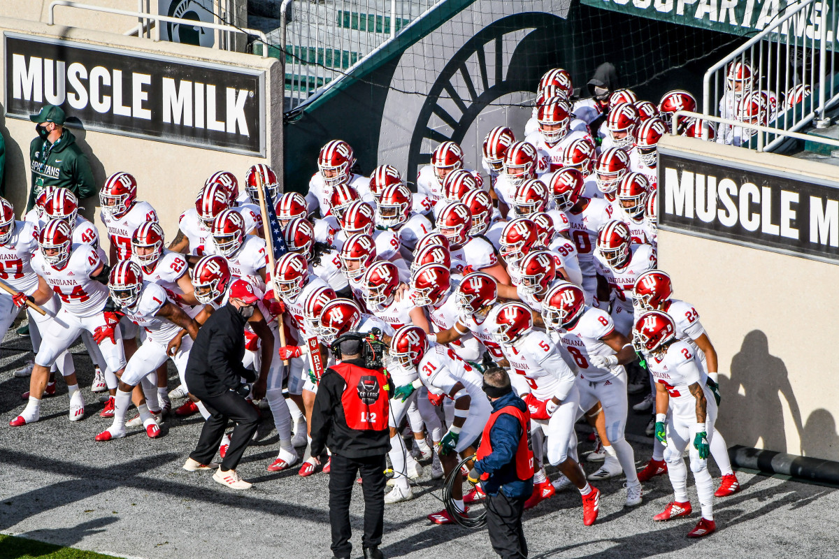 Indiana football runs out of the tunnel at Michigan State