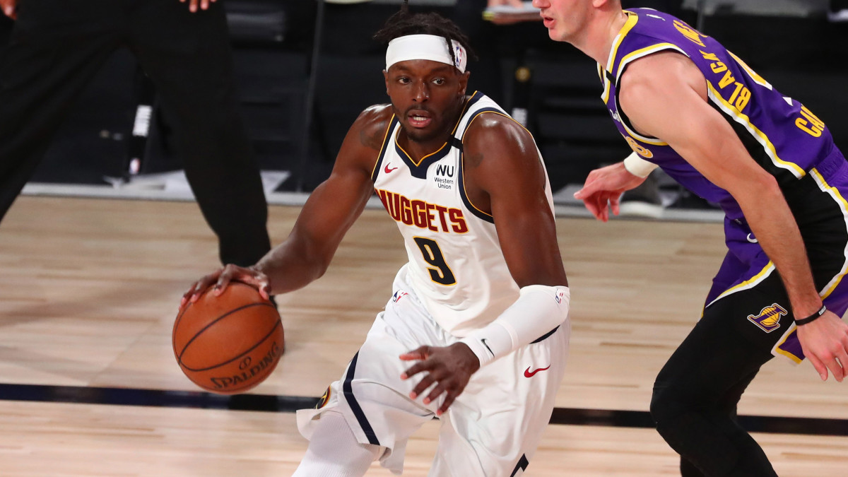Denver Nuggets forward Jerami Grant (9) drives past Los Angeles Lakers guard Alex Caruso (4) during the first half in game five of the Western Conference Finals of the 2020 NBA Playoffs.