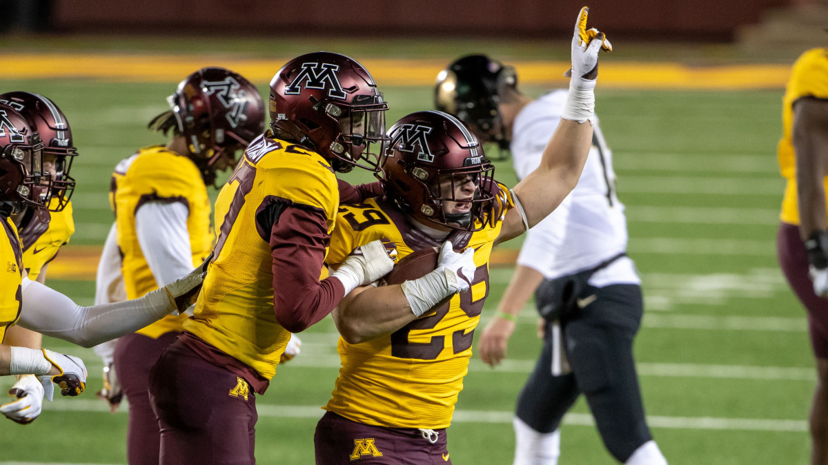 Minnesota Golden Gophers linebacker Josh Aune (29) celebrates with defensive back Tyler Nubin (27) after intercepting a pass in the fourth quarter against the Purdue Boilermakers at TCF Bank Stadium.