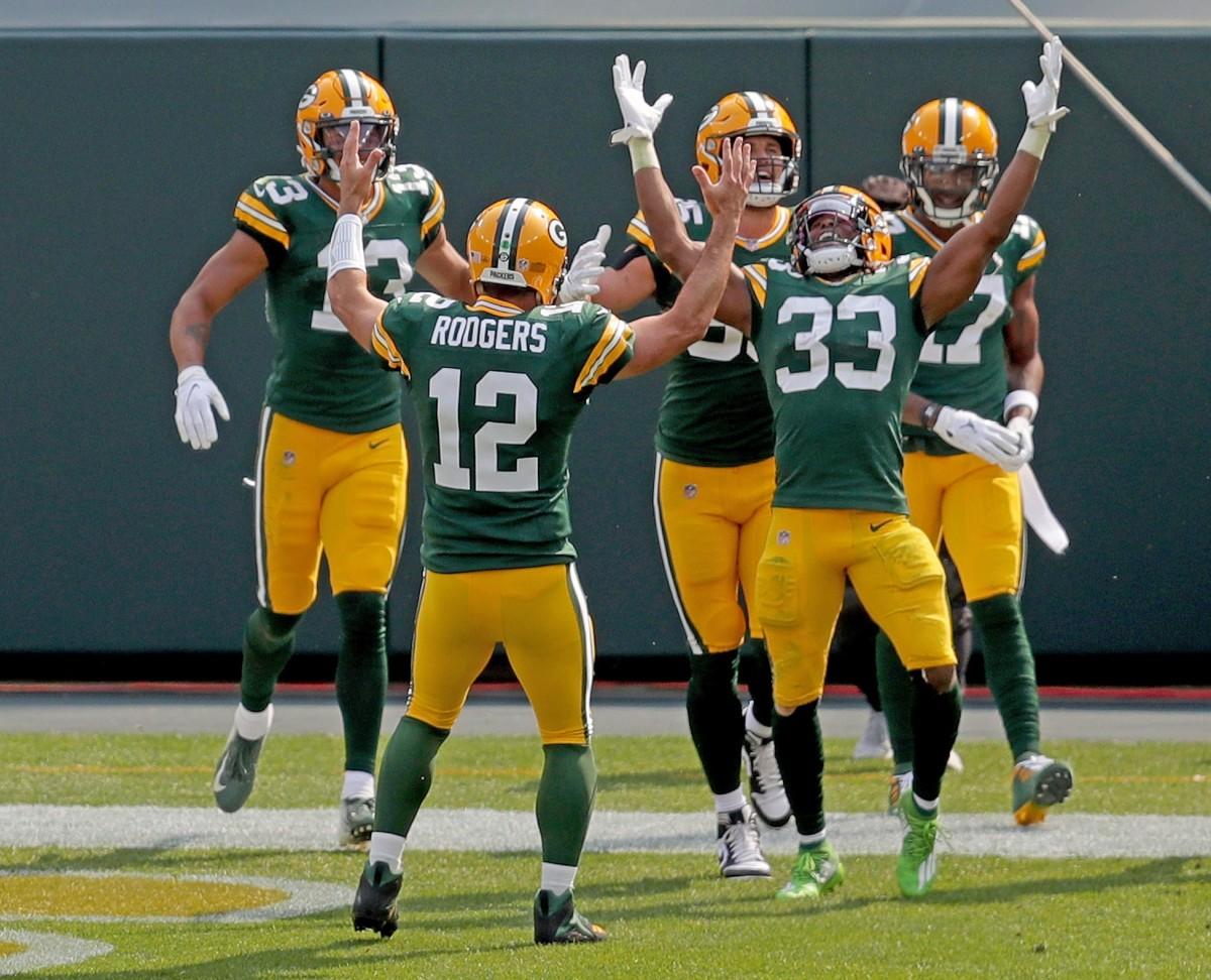 The Green Bay Packers celebrate an Aaron Jones (33) touchdown.