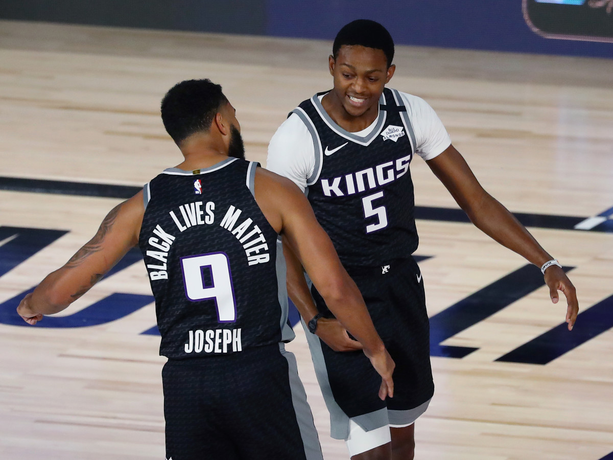 acramento Kings guard Cory Joseph (9) and guard De'Aaron Fox (5) celebrate during the first half of a NBA basketball game against the Dallas Mavericks