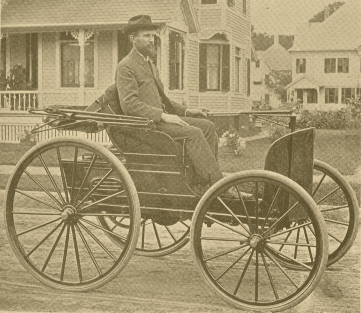 """The Duryea brothers' """"road wagon,"""" not quite at cruising speed, in Springfield."""