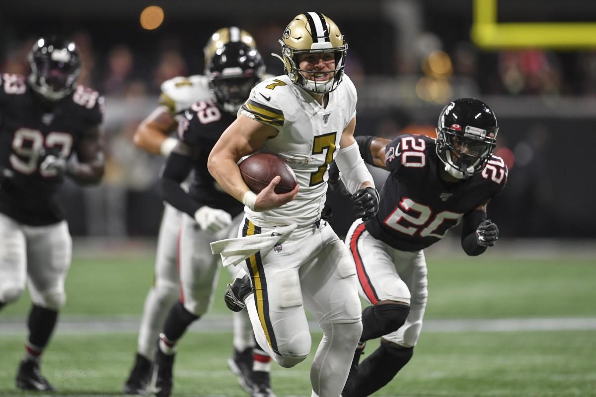 Nov 28, 2019; Atlanta, GA, USA; New Orleans Saints quarterback Taysom Hill (7) runs through the Atlanta Falcons defense for a touchdown during the first half at Mercedes-Benz Stadium. Mandatory Credit: Dale Zanine-USA TODAY