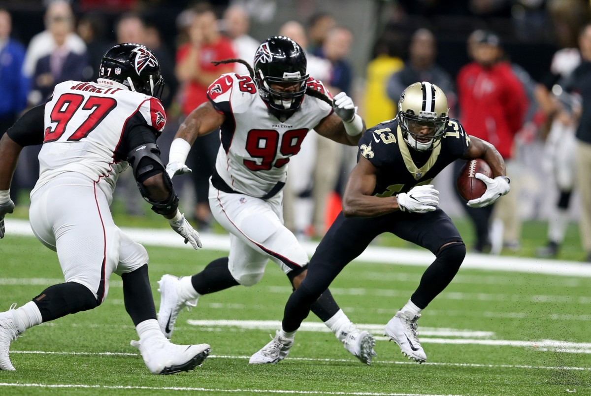 Dec 24, 2017; New Orleans, LA, USA; New Orleans Saints wide receiver Michael Thomas (13) is defended by Atlanta Falcons defensive tackle Grady Jarrett (97) Mandatory Credit: Chuck Cook-USA TODAY Sports