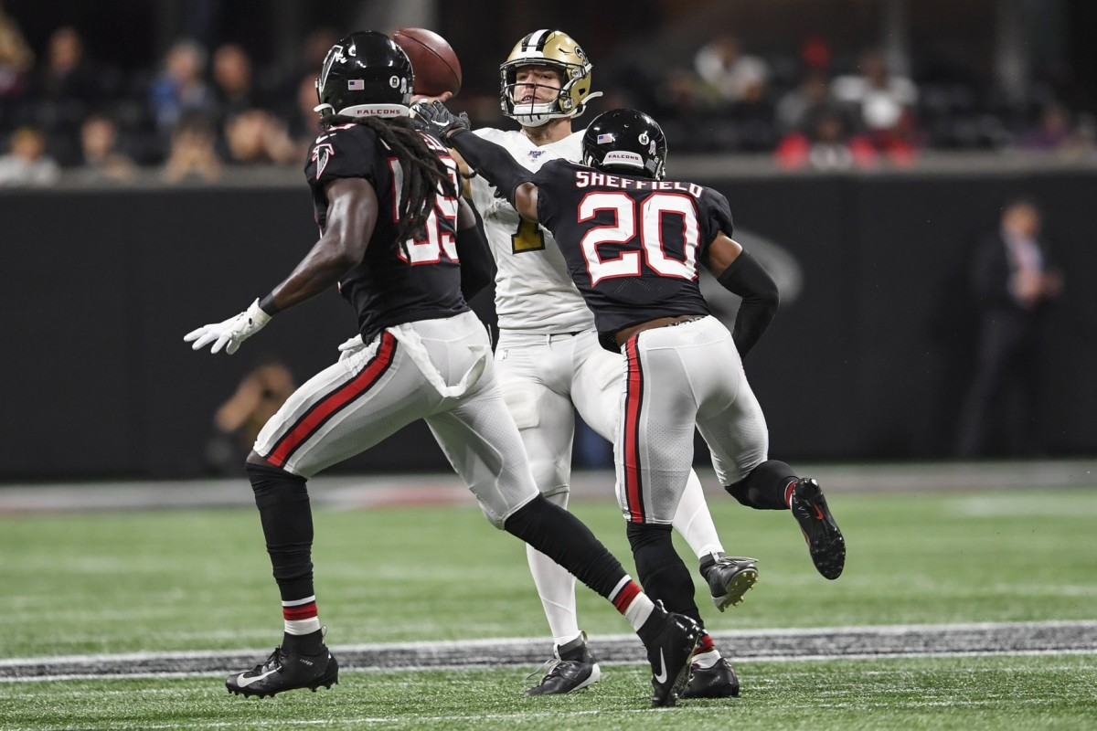 Nov 28, 2019; Atlanta, GA, USA; New Orleans Saints quarterback Taysom Hill (7) throws a pass over pressure from Atlanta Falcons defensive back Kendall Sheffield (20) and outside linebacker De'Vondre Campbell (59) during the second half at Mercedes-Benz Stadium. Mandatory Credit: Dale Zanine-USA TODAY