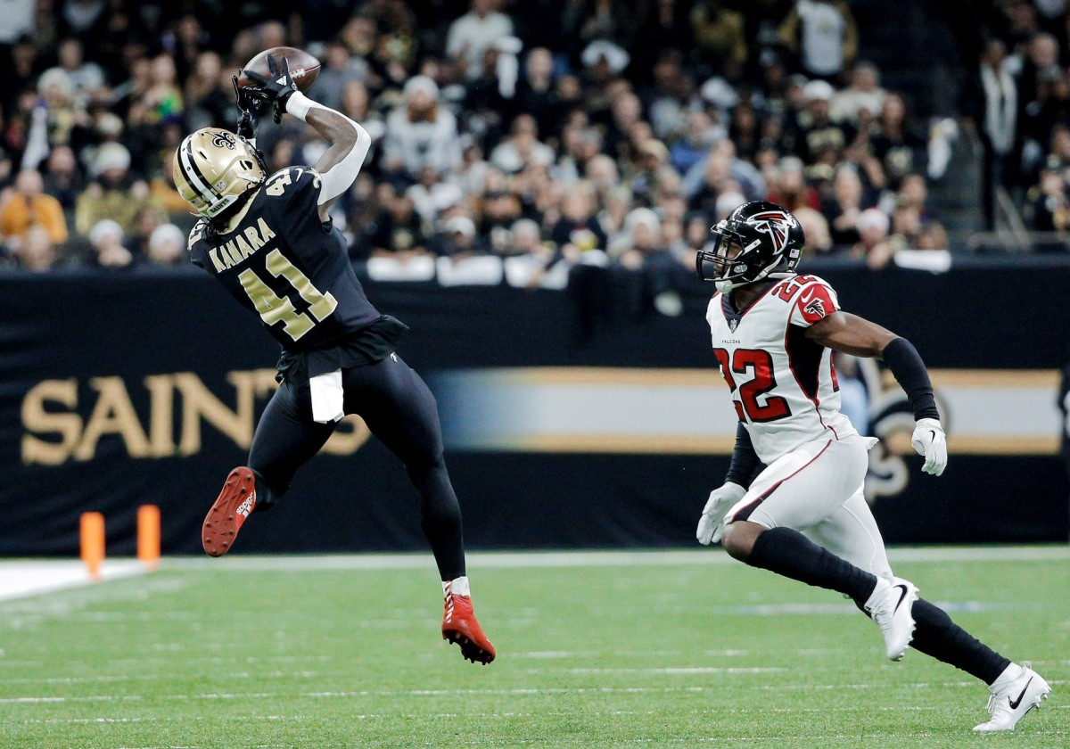 Dec 24, 2017; New Orleans, LA, USA; New Orleans Saints running back Alvin Kamara (41) catches a pass over Atlanta Falcons strong safety Keanu Neal (22) during the first quarter at the Mercedes-Benz Superdome. Mandatory Credit: Derick E. Hingle-USA TODAY
