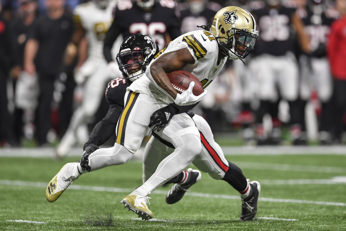 Nov 28, 2019; Atlanta, GA, USA; New Orleans Saints running back Alvin Kamara (41) runs against Atlanta Falcons linebacker Deion Jones (45) during the first quarter at Mercedes-Benz Stadium. Mandatory Credit: Dale Zanine-USA TODAY