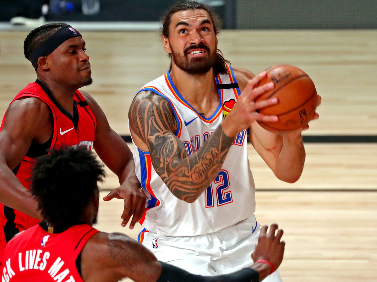 Aug 20, 2020; Lake Buena Vista, Florida, USA; Oklahoma City Thunder center Steven Adams (12) shoots the ball against Houston Rockets forward Robert Covington (33) during the first quarter in an NBA basketball first round playoff game of the 2020 NBA playoffs at AdventHealth Arena.