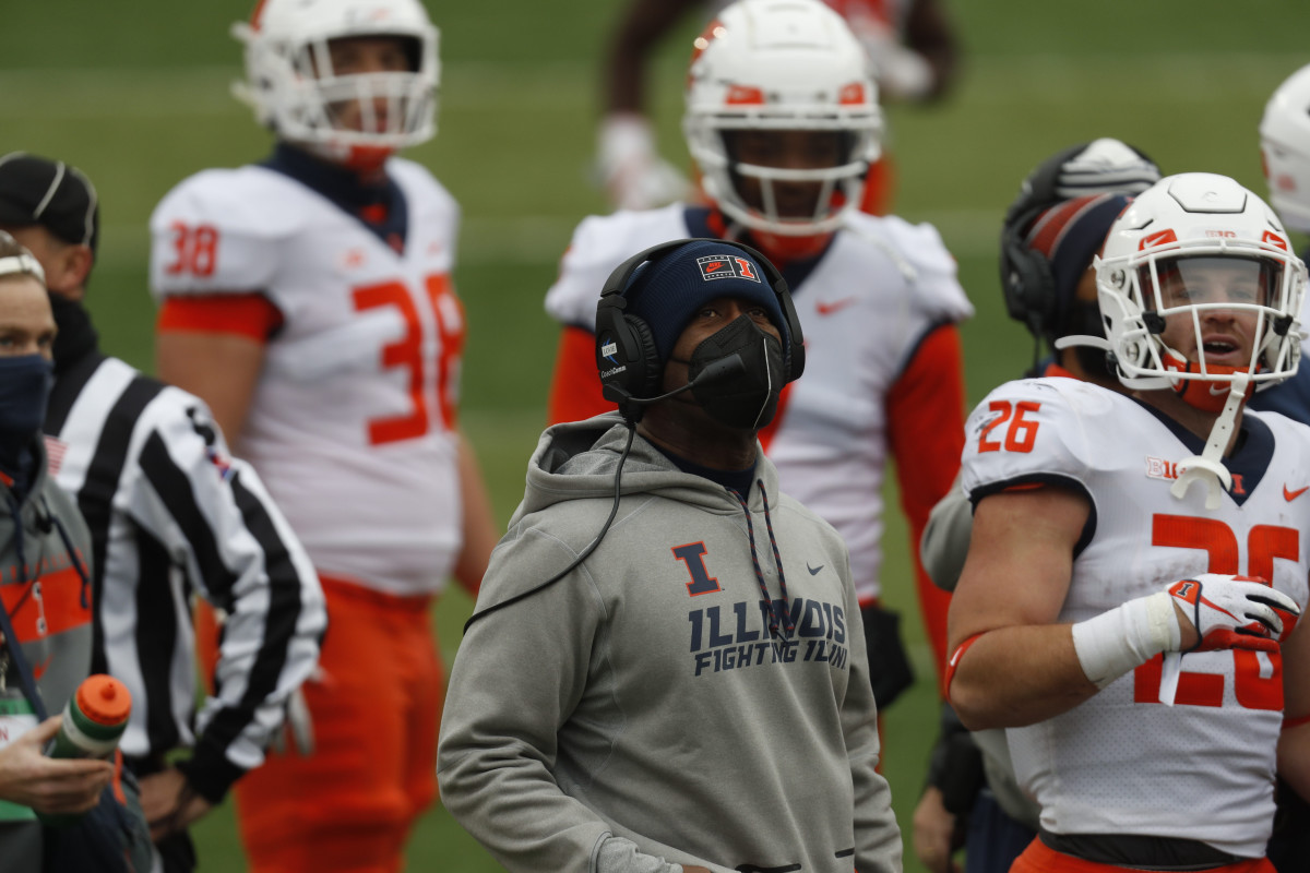 Illinois Fighting Illini head coach Love Smith watches a replay during the game against the Nebraska Cornhuskers in the second half at Memorial Stadium.